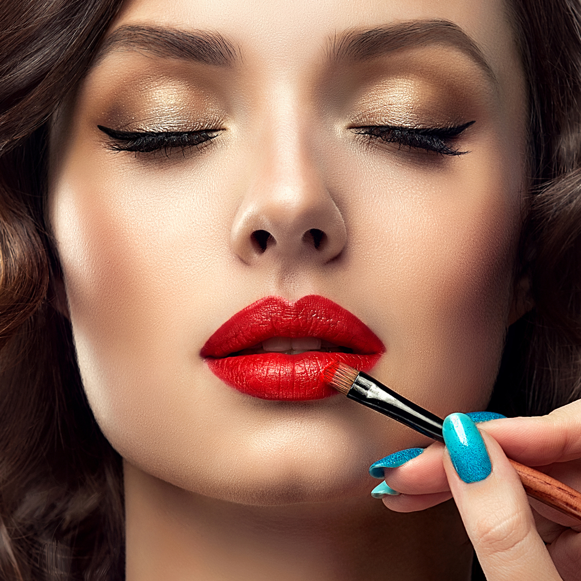 Apply the lipstick with the aid of a thin brush.